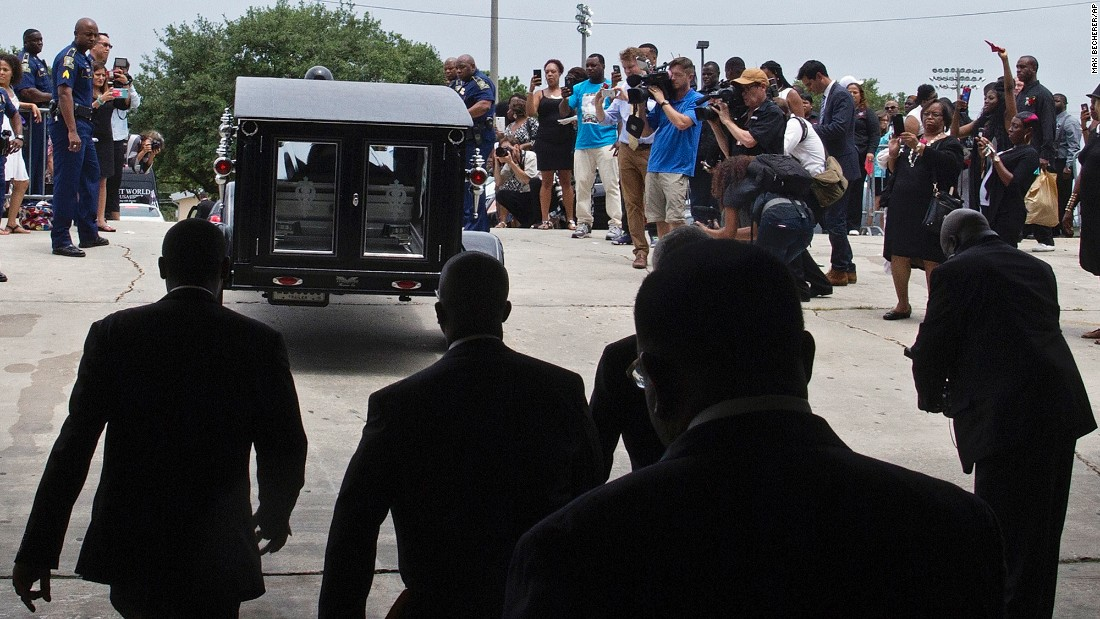 The casket of Alton Sterling is driven away after his funeral.