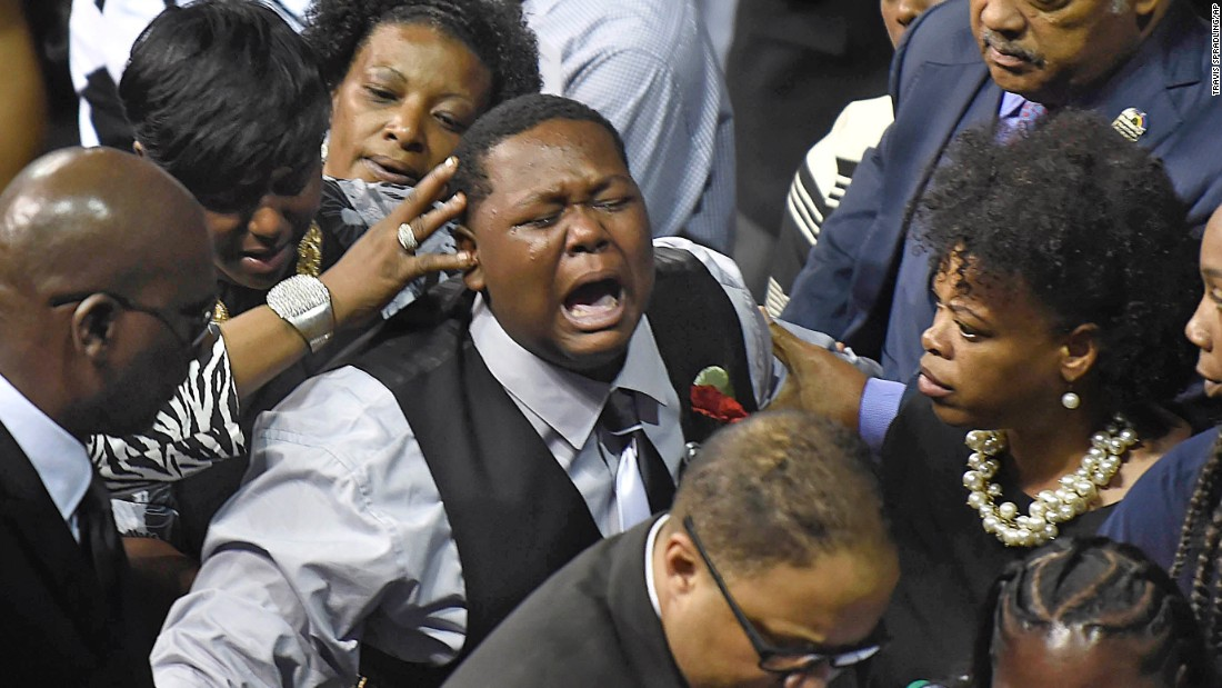 Alton Sterling's son Cameron cries as he precedes his father's casket after the funeral for his father at the F.G. Clark Activity Center in Baton Rouge on July 15.