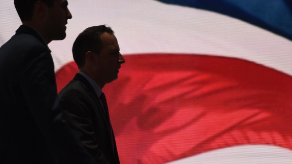 RNC Chairman Reince Priebus,(R)walks on the stage at the Quicken Loans Arena on July 17, 2016, as as preparations continue ahead of the Republican National Convention in Cleveland, Ohio. / AFP / TIMOTHY A. CLARY        (Photo credit should read TIMOTHY A. CLARY/AFP/Getty Images)