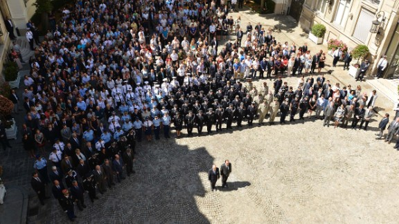 A ceremony is held at the Hotel de Beauvau at the French Interior Ministry to observe a moment's silence to honor those killed in the truck attack.
