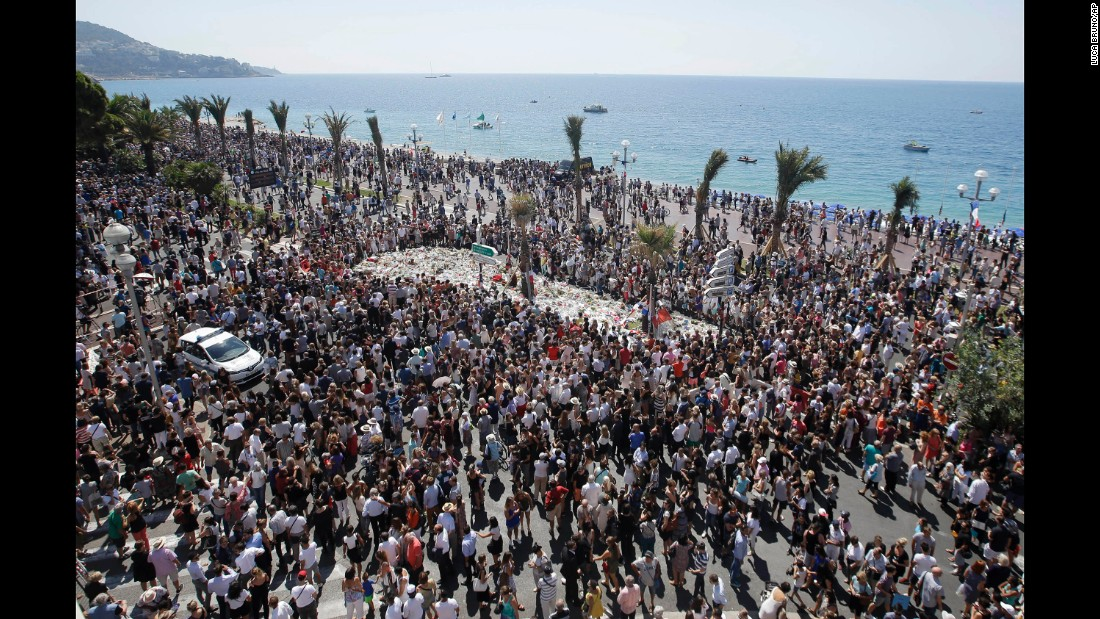 People observe a national moment of silence on Monday, July 18, in Nice near where a truck mowed through crowds on the Promenade des Anglais during Bastille Day celebrations. France is holding a national moment of silence to honor the 84 victims killed in the truck rampage.