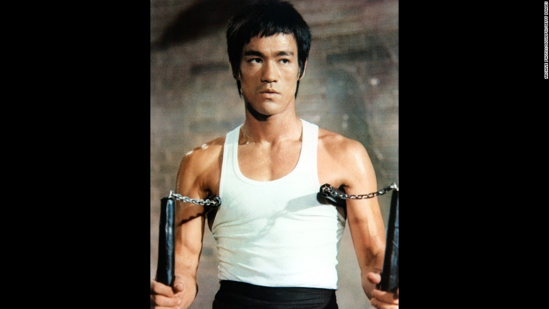 Bruce Lee with his signature weapon, the dreaded nunchakus. The weapon was actually introduced to him by his training partner. Lee's ability to learn it so quickly amazed his partner.<br />.