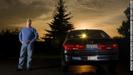 Wayne Gerdes with his stock Honda Accord, which he gets as much as 60 mpg out of.