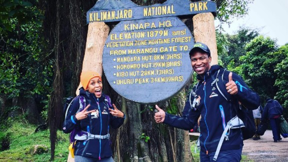 Gugu Zulu and his wife Letshego pictured at the start of their trek up Mount Kilimanjaro.