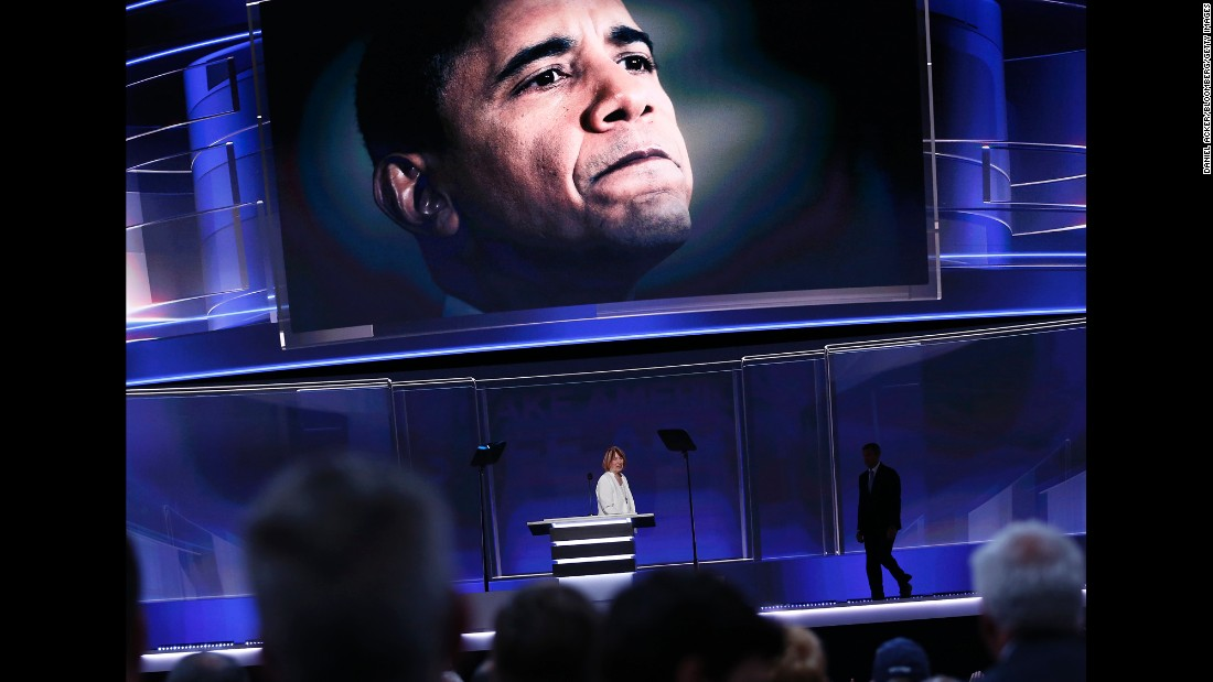 President Barack Obama is seen on a screen as Smith leaves the stage Monday.