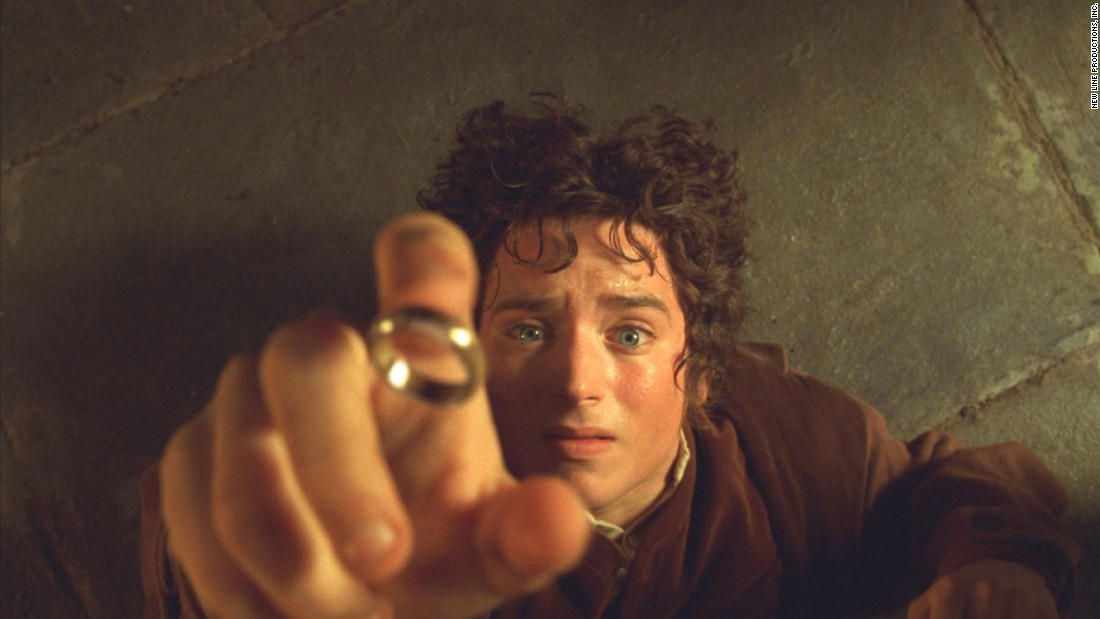 "Actor Elijah Wood as Frodo Baggins in ""The Lord of the Rings: The Fellowship of the Ring"" with the One Ring, which makes the wearer invisible."