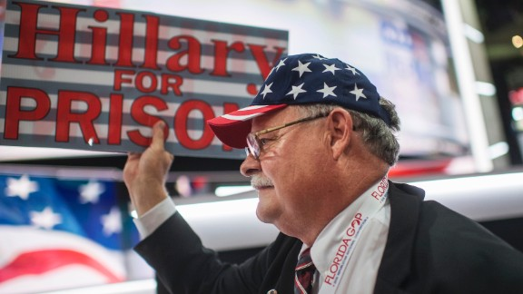 "A Florida delegate holds a ""Hillary for prison"" sign on the floor of the arena."