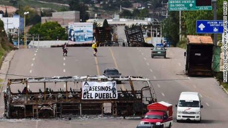 Teachers block a road at the entrance of the village of Nochixtlan, Oaxaca State, Mexico on July 4, 2016.  Ten people died and more than 100 were injured on June 19, in the southern state of Oaxaca, where the radical CNTE teachers union has blocked roads in protest against President Enrique Pena Nieto's education reform / AFP / RONALDO SCHEMIDT        (Photo credit should read RONALDO SCHEMIDT/AFP/Getty Images)