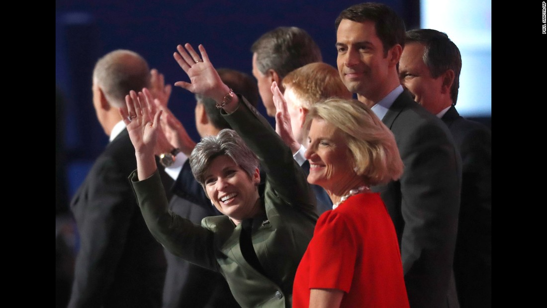 U.S. Sen. Joni Ernst waves as she stands with other first-term senators on Tuesday.