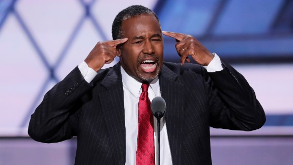 "Ben Carson, a retired neurosurgeon and former presidential candidate, speaks on stage Tuesday. He said Trump skeptics who would vote for Hillary Clinton are ""not using their God-given brain to think about what they"