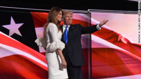 Republican presidential candidate Donald Trump introduces his wife Melania Trump on the first day of the Republican National Convention on July 18, 2016 at the Quicken Loans Arena in Cleveland, Ohio. The Republican Party opened its national convention, kicking off a four-day political jamboree that will anoint billionaire Donald Trump as its presidential nominee.  / AFP / TIMOTHY A. CLARY        (Photo credit should read TIMOTHY A. CLARY/AFP/Getty Images)