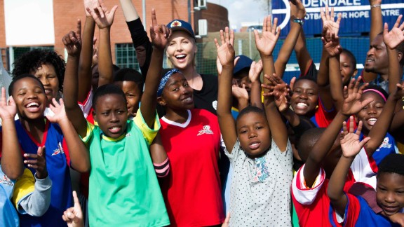 Theron with children from WhizzKids United, a youth project funded by her foundation, the Charlize Theron Africa Outreach Project.