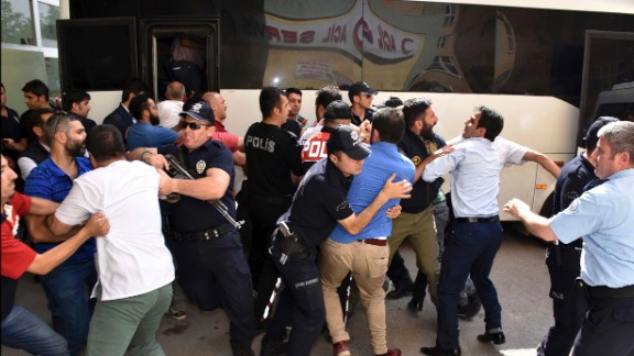 Police try to stop people from attacking a judge, suspected in the failed coup plot, in Erzurum, Turkey on Tuesday, July 19. Turkey has fired or suspended about 50,000 people as the government intensifies a crackdown following last weekend