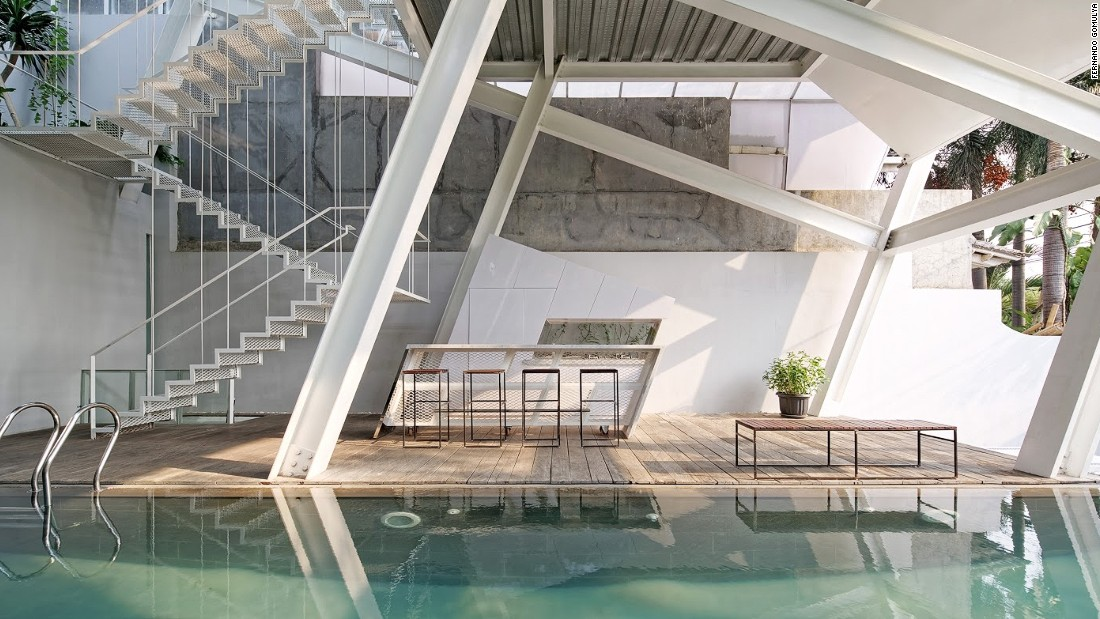 "The open-plan ground floor features a stunning pool. Budi Pradono is proud of this entry point to the property, saying it has an undeniable ""wow factor."""