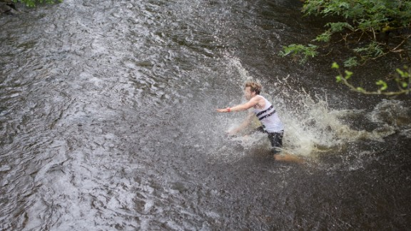 By the time they reach the last two miles and hit the waist-high river crossing, many of the racers fall down, buckling under weakened legs.