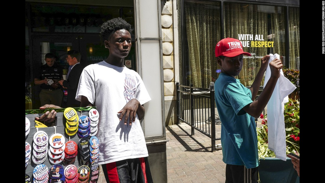 Young men sell Donald Trump merchandise and apparel on East 4th Street.