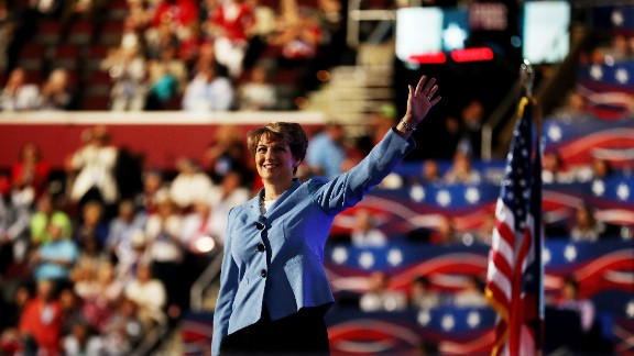 Retired astronaut Eileen Collins waves to the crowd before delivering a speech Wednesday.