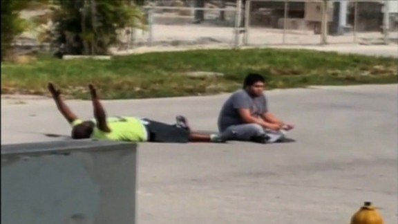 Charles Kinsey lies on the ground with his hands up. He was shot in the leg by North Miami police.