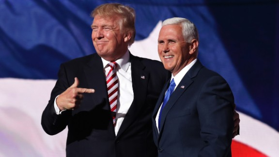 Republican presidential candidate Donald Trump stands with Republican vice presidential candidate Mike Pence and acknowledge the crowd on the third day of the Republican National Convention on July 20, 2016 at the Quicken Loans Arena in Cleveland, Ohio. Republican presidential candidate Donald Trump received the number of votes needed to secure the party's nomination. An estimated 50,000 people are expected in Cleveland, including hundreds of protesters and members of the media. The four-day Republican National Convention kicked off on July 18.
