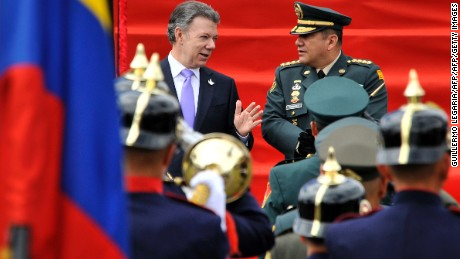 Colombian President Juan Manuel Santos (L) speaks with Colombia's Armed Forces Commander General Juan Pablo Rodriguez (R) during a military parade held to celebrate the country's 206th Anniversary of Independence, in Bogota, on July 20, 2016. / AFP / GUILLERMO LEGARIA        (Photo credit should read GUILLERMO LEGARIA/AFP/Getty Images)