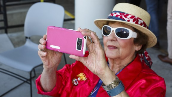 A woman takes a photo during the convention.