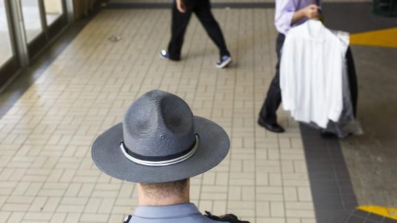 A law enforcement officer keeps watch.