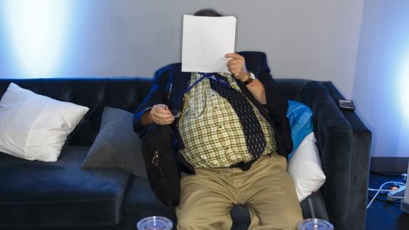 A man reads on Media Row.