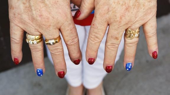 A woman displays her patriotic nails.
