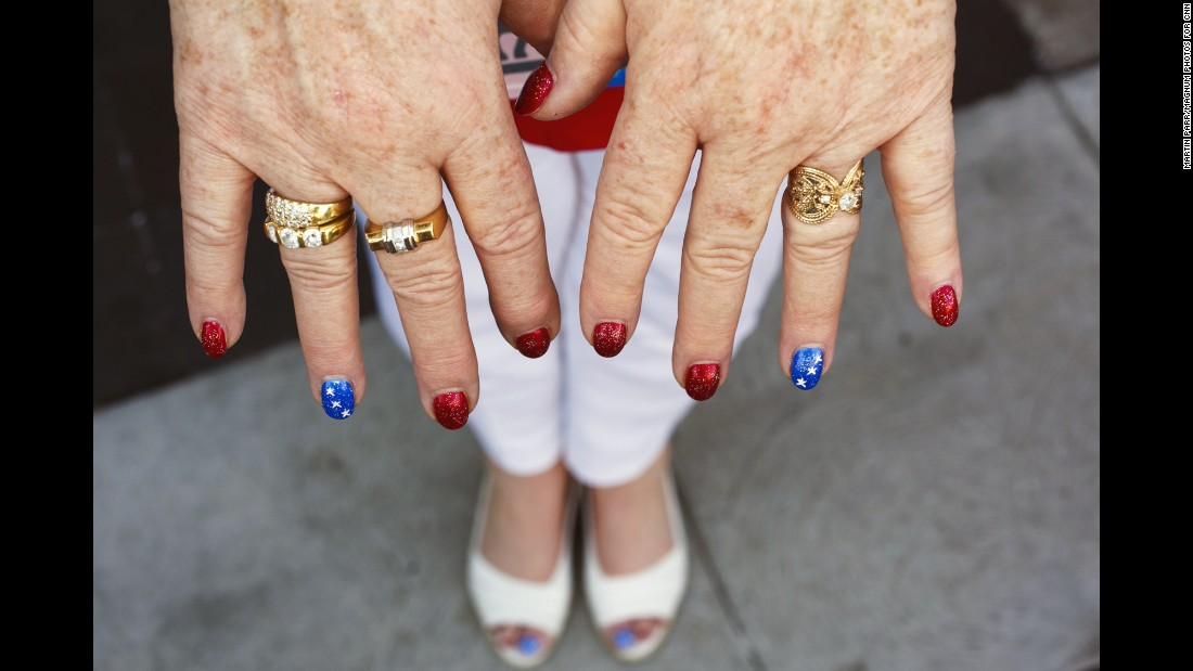 A woman displays her patriotic nails.