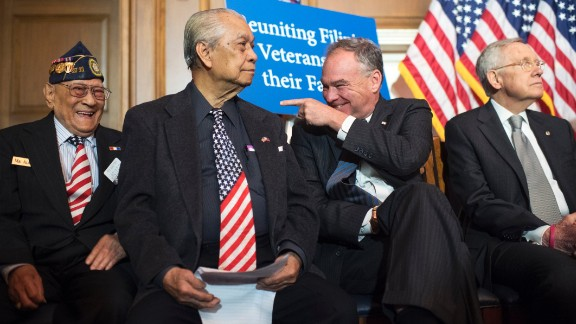 Kaine, along with World War II veterans and Senate Minority Leader Harry Reid, attend a news conference on Capitol Hill on June 9.