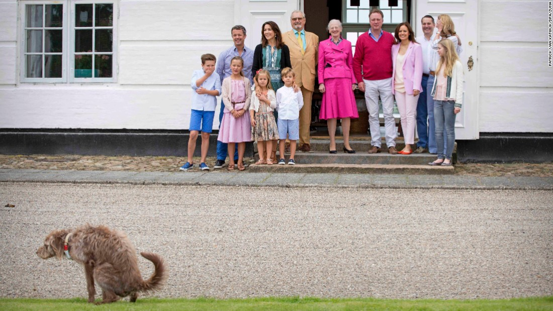 Nature calls as the Danish royal family poses for media photos on Friday, July 15.