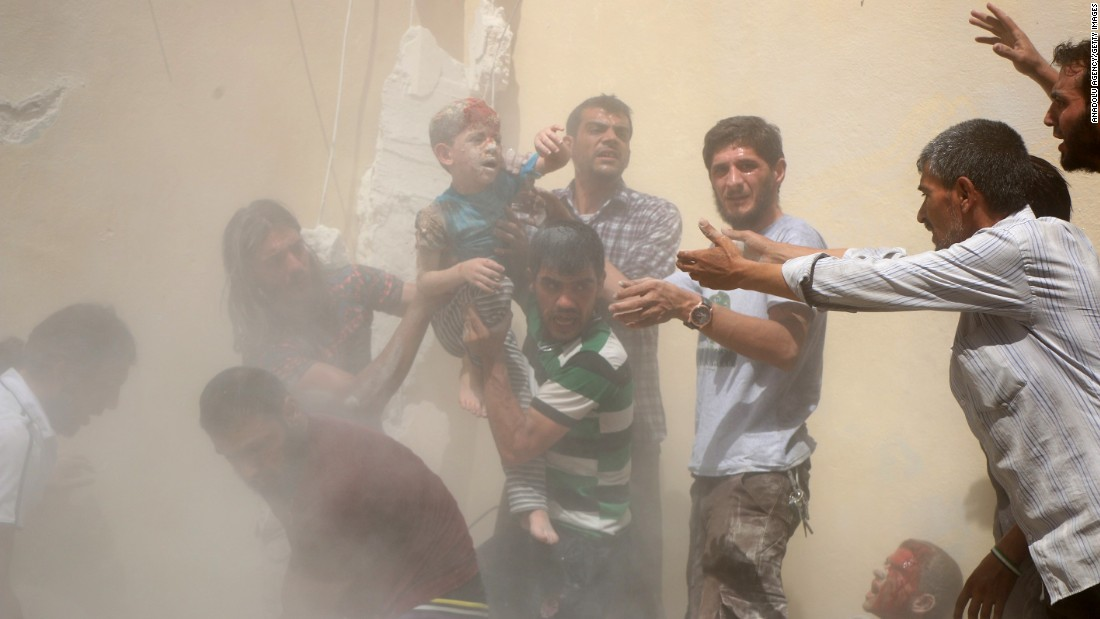 "A boy who was wounded in a bombing is carried in Aleppo, Syria, on Sunday, July 17. Aleppo <a href=""http://www.cnn.com/2016/07/17/middleeast/syrian-army-road-aleppo/"" target=""_blank"">has been a major battlefield in Syria</a> since 2010, with fierce fighting between rebel groups and regime forces."