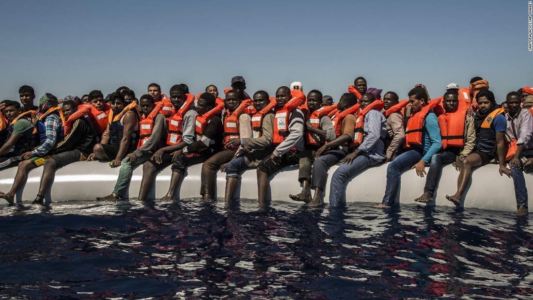 "Migrants sit on a dinghy Tuesday, July 19, waiting to be rescued in the Mediterranean Sea near Libya. <a href=""http://www.cnn.com/2015/09/03/world/gallery/europes-refugee-crisis/"" target=""_blank"">Europe's migration crisis in 25 photos</a>"