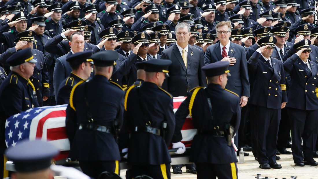 "An honor guard carries the flag-draped casket of Dallas police officer Michael Krol on Friday, July 15. Krol was one of the five Dallas police officers <a href=""http://www.cnn.com/2016/07/20/us/dallas-shooter-micah-johnson-movements/"" target=""_blank"">killed by a gunman</a> earlier this month."