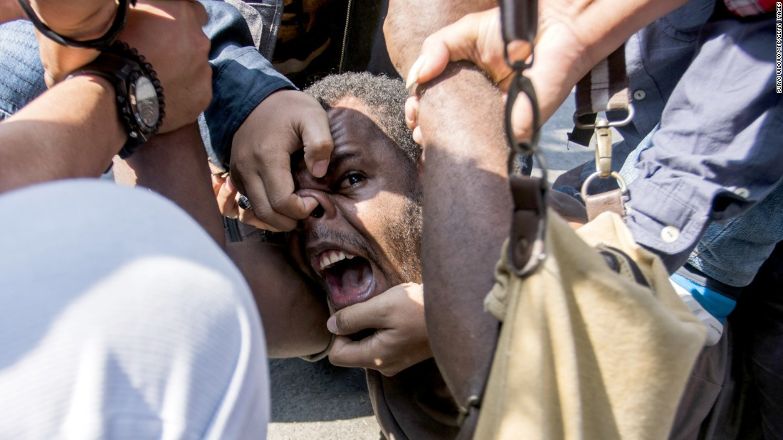 Papuan student Obi Kogoya screams as he is taken down by police while trying to join a protest in Yogyakarta, Indonesia, on Friday, July 15. Pro-independence sentiment runs high in Papua, which sits on the western end of the New Guinea island.