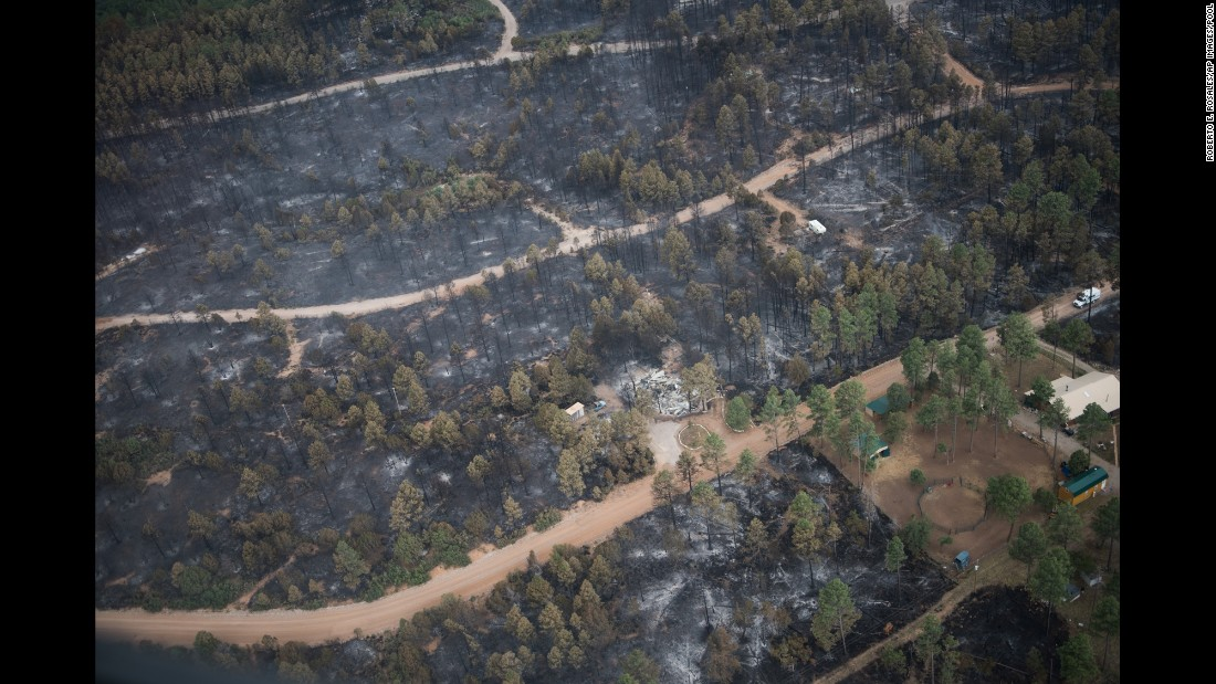 This aerial photo shows the remains of a home that was consumed by a wildfire in the village of Timberon, New Mexico, on Friday, July 15. New Mexico Gov. Susana Martinez declared a state of emergency in response to a wildfire in Otero County.
