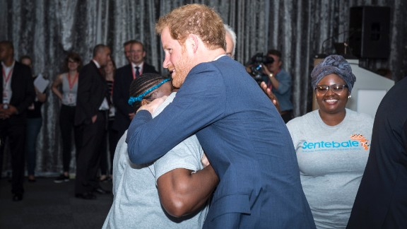 Prince Harry, as he arrived at the International AIDS Conference and greeted someone from his charity, Sentebale.