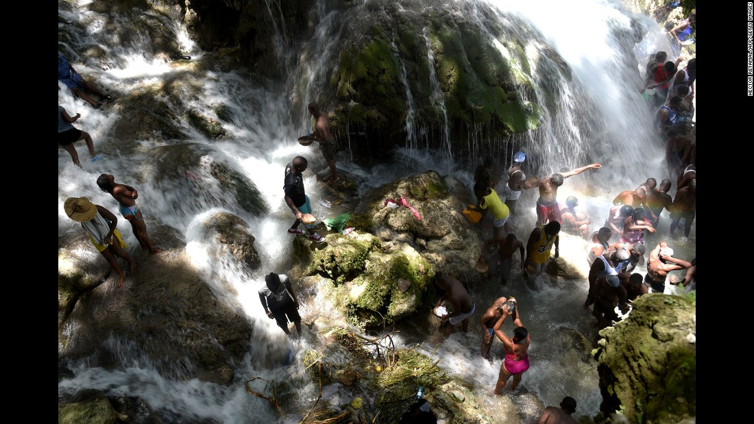 People bathe at a waterfall during the annual pilgrimage in Saut-d'Eau, Haiti, on Saturday, July 16.