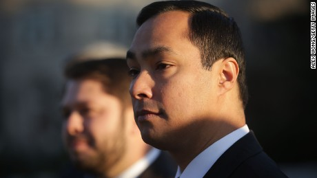 U.S. Rep. Joaquin Castro (D-TX) (R) listens during a news conference in front of the Supreme Court December 8, 2015 in Washington, DC.
