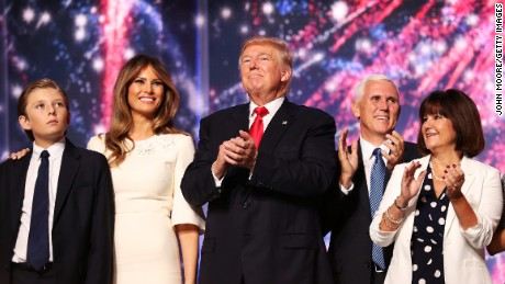 (L-R) Barron Trump, Melania Trump, Republican presidential candidate Donald Trump, Republican vice presidential candidate Mike Pence and Karen Pence acknowledge the crowd at the end of the the Republican National Convention on July 21, 2016 at the Quicken Loans Arena in Cleveland, Ohio. Republican presidential candidate Donald Trump received the number of votes needed to secure the party's nomination. An estimated 50,000 people are expected in Cleveland, including hundreds of protesters and members of the media. The four-day Republican National Convention kicked off on July 18. (Photo by John Moore/Getty Images)