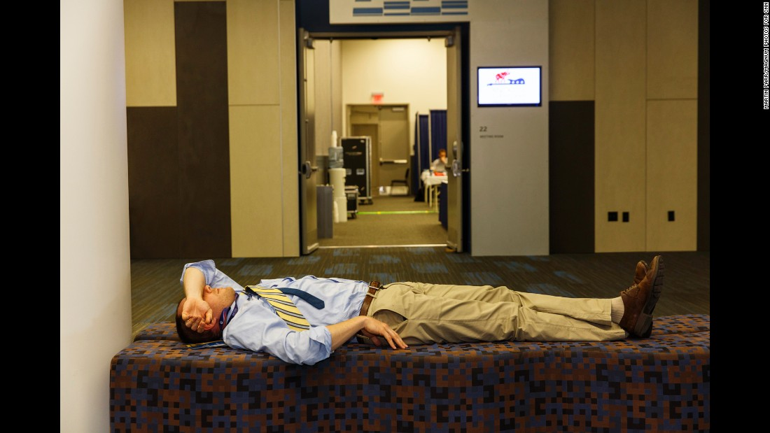 A man rests at a nearby convention center where many media members were working.