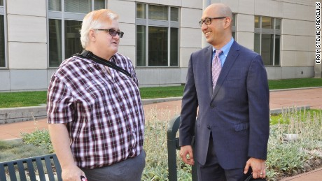 Dana Zzyym, left, speaks to attorney Paul Castillo of Lambda Legal in Denver, Colorado, on July 20.
