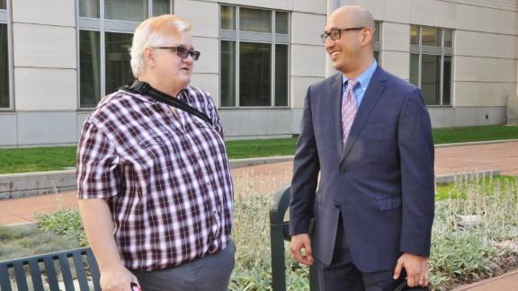 Dana Zzyym, left, speaks to attorney Paul Castillo of Lambda Legal in Denver, Colorado, on July 20.
