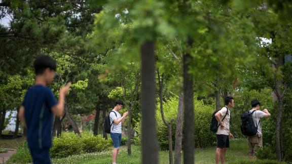 South Koreans youths play Pokemon Go on July 15 in Sokcho, South Korea.