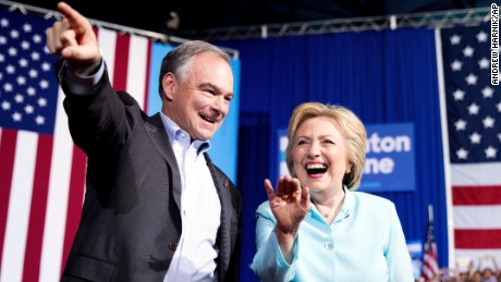 Democratic presidential candidate Hillary Clinton and Senator Tim Kaine arrive at a rally at Florida International University Panther Arena in Miami, Saturday, July 23.