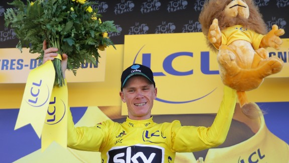 A happy Froome becomes reacquainted with the yellow jersey at the end of the stage.