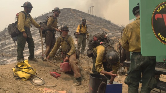 Firefighters with the Valyermo Hotshots of the Angeles National Forest get ready to go back to work on Little Tujunga Canyon Road in Santa Clarita.