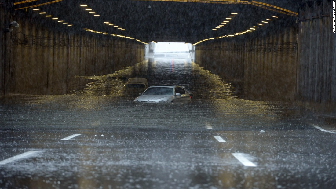 Cars are submerged by floodwater in Beijing on July 20. This year's flood season has been the worst since 1998, according to state media,  with 26 provinces affected. The 1998 floods led to the deaths of almost 4,000 people.