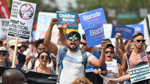 Bernie Sanders supporters march through downtown on the first day of the Democratic National Convention (DNC) on July 25, 2016 in Philadelphia, Pennsylvania. The convention is expected to attract thousands of protesters, members of the media and Democratic delegates to the City of Brotherly Love.