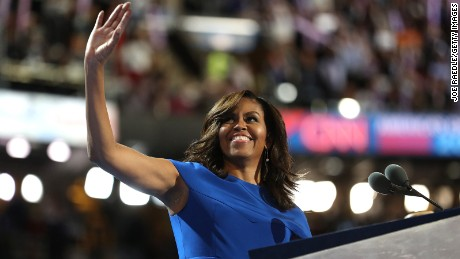 First lady Michelle Obama acknowledges the crowd before delivering remarks on the first day of the Democratic National Convention at the Wells Fargo Center, July 25, 2016 in Philadelphia, Pennsylvania.